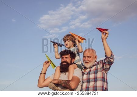 Three Different Generations Ages: Grandfather Father And Child Son Together. Family Holiday And Toge