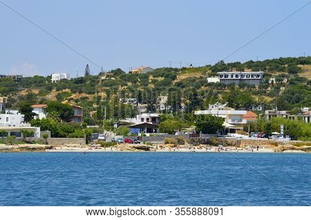 Anissaras Crete, Greece - June 11, 2019 : Tourists On Anissaras Beach In Crete The Largest And Most