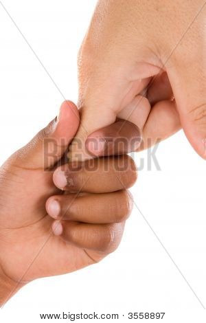 Two Hands Of Different Races Together