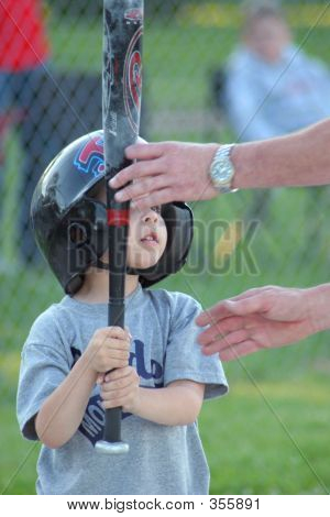 Boy Getting Help From Dad
