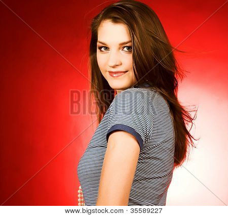 beautiful girl  smiling over a red background