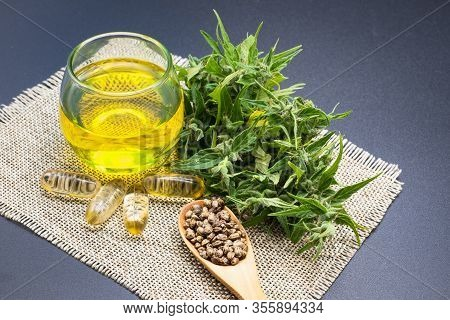 Glass Bottle With Cbd Hemp Oil And Medicine Extracted From Hemp Oil, Placed On A Black Background He