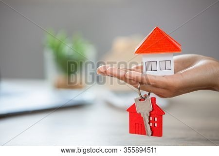 Real Estate Agents Hold House Keys And Have Houses Placed On Their Hands. Ideas For Real Estate, Mov