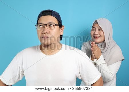 Muslim Couple Having Conflict, Wife Trying To Resolve, Persuade And Apologize To Her Husband After F