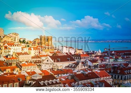 View Of Lisbon Over Old Town Quarters With Se Cathedral At Night, Portugal, Toned