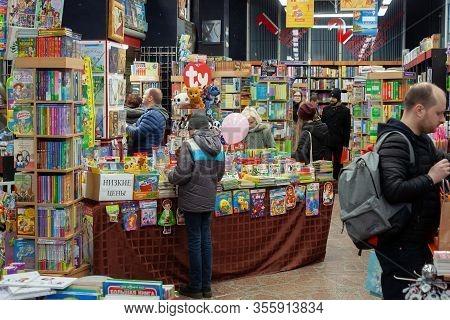 Minsk, Belarus - March 3, 2020: People Choose Book In A Bookstore.
