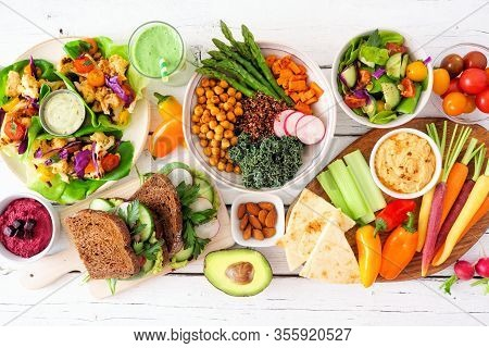 Healthy Lunch Table Scene With Nutritious Lettuce Wraps, Buddha Bowl, Vegetables, Sandwiches, And Sa