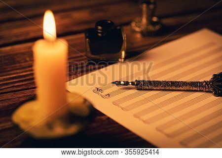 Vintage Manuscript - Writing Musical Notes In Candlelight