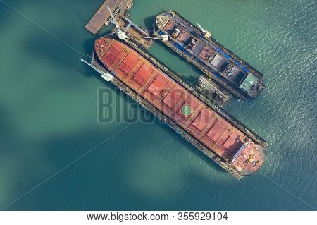 Aerial View Shipyard At Sea In The Process Of Assembling A Container Ship.