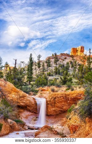 Lonely mountain and river with a small waterfall in Zion National Park. Utah, United States of America. Long exposure