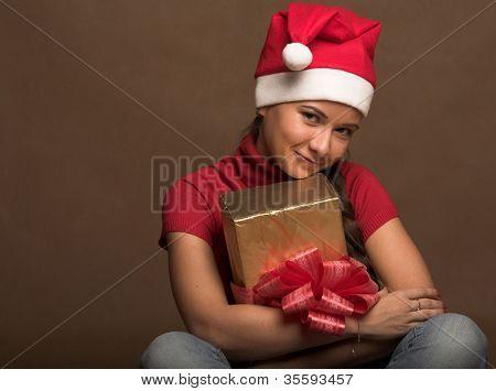 happy santa helper girl with gold gift box