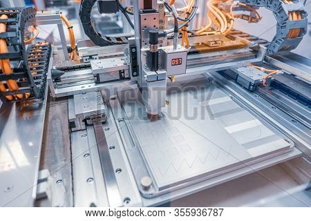 Metalworking CNC lathe milling machine. Cutting metal modern processing technology. Milling is the process of machining using rotary cutters to remove material by advancing a cutter into a workpiece.