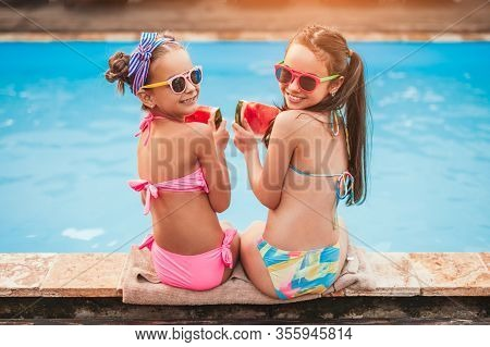 High Angle Back View Of Happy Friends In Sunglasses And Colorful Swimsuits With Slices Of Fresh Tast