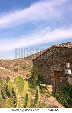 Vertical View Of A Stone House With A Cactus In The Foreground In The Village Of Patones De Arriba I