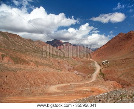 Beautiful Landscape Panorama Of Pamir Mountains Area In Kyrgyzstan. Red Colored Mountain. Pamir High