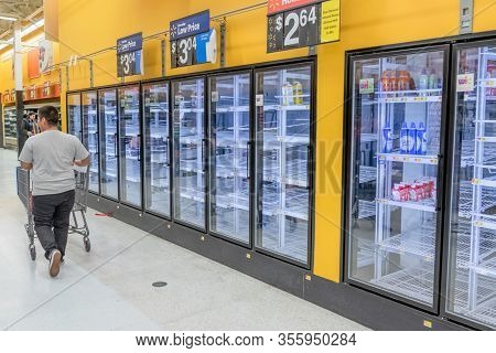 Empty Frozen Food Section In Supermarket Amidst Covid-19 Concerns.