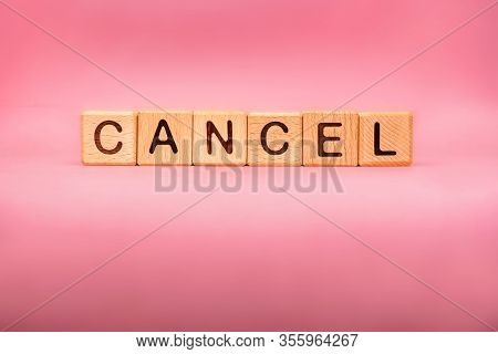 Cancel Word Made With Building Blocks, Business Concept. Word Cancel On Pink Background.