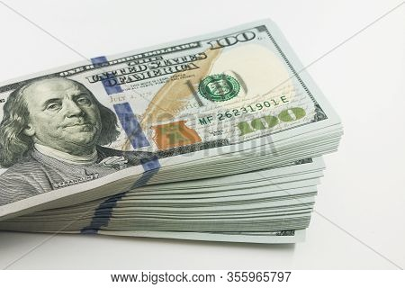 Stack Of American Money, One Hundred Dollar Cash Banknotes On White Background, Lot Of One Hundred D