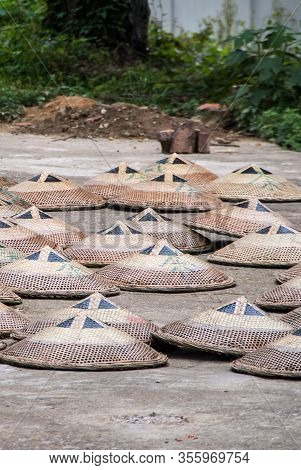 Guilin, China - May 11, 2010: Tea Institute. Group Of Brown-beige Hats Also Used As Tea Leave Collec