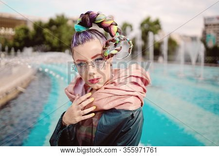 Fashionable Funky Girl Portrait With An Extravagant Look On Streets. Woman With Avant Garde Hairstyl