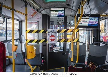 Warsaw, Poland - March 17, 2020: Closed driver area in public bus in Warsaw after Polish government has declared a state of epidemic threat to limit spread of Coronavirus