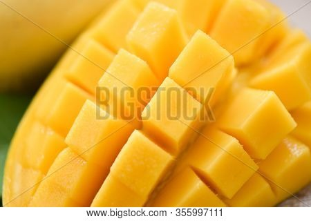 Mango Slice And Mango Leaves From Tree Tropical Summer Fruit Concept / Close Up Sweet Ripe Mangos Cu