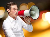 Portrait Of Young Man Shouting On Megaphone, Outdoor poster