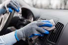 Auto Service Staff Hand Cleaning Car Interior With Microfiber Cloth. Car Detailing And Valeting Conc