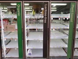 Chicago, Il March 14, 2020, Target Grocery Store Shelves Completely Empty Of Milk And Orange Juice D