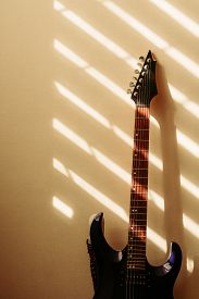 Electric Guitar Against The Wall. Vintage Photo