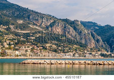 View Of Ligurian Alps And Menton City From The Mediterranean Sea - France