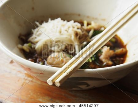 Chopsticks and Wet Boat Noodles with Pork, Thai Street Food