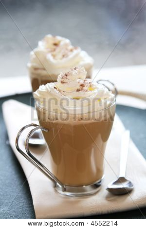 Coffee Latte Macchiato With Cream In Glasses
