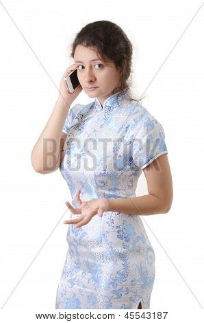 Caucasian Girl In The Chinese Dress With A Mobile Phone