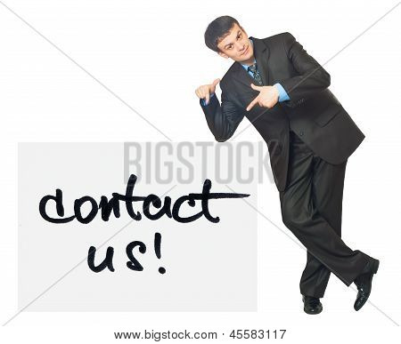 Young Businessman Points On A Card Contact Us On A White