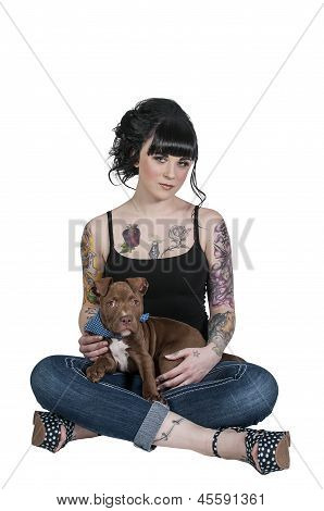 Beautiful young woman with her pit bull puppy poster