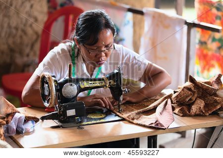 Balinese Female Tailor Sew On A Machine