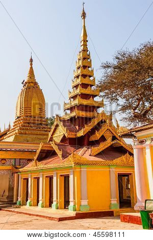 Temple in The Shwezigon Pagoda complex. Itis a Buddhist temple located in Nyaung-U a town near Bagan in Burma built by King Anawrahta. poster