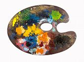 wooden artists palette loaded with various colour paints and brush, isolated on a white background poster