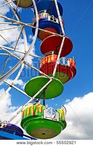 Ferris Wheel on a Blue Sky Background
