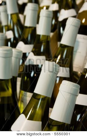 few Bottles Of white Wine and blurred background poster