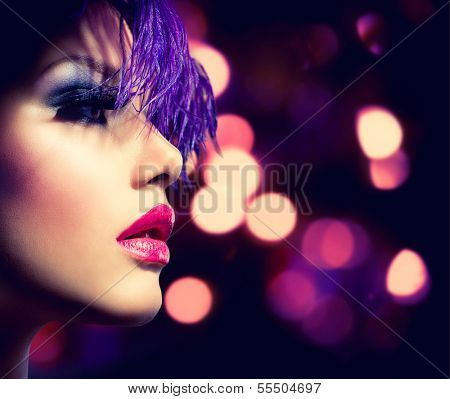 Fashion Model Girl. Holiday Woman over Glowing Bokeh Background. Fashion Art Girl Portrait With Violet Hair. Creative Hairstyle and Makeup. Make-up. Darkness. Night Party