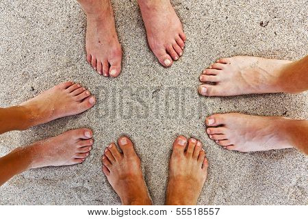 feet of happy family at the beach poster