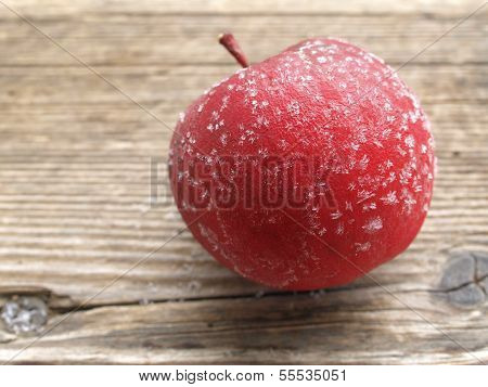 frosted red apple on a wooden board poster