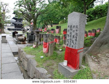 Jizo statues for unborn (miscarried aborted or stillborn) children in a shady cemetary at the Kofuku-Ji Three Storied Pagoda in Nara. Jizo is a Bodhisattva believed to protect children poster
