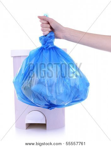 Hand holding trash bag, isolated on white