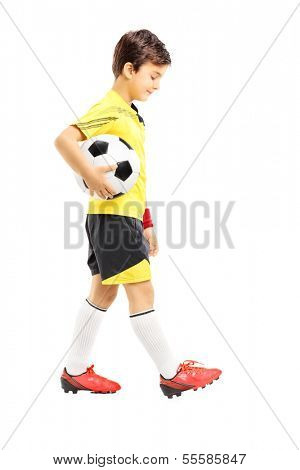 Full length portrait of a sad kid in sportswear posing with a soccer ball isolated on white background