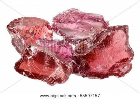 A pile of purple red rhodolite garnet gemstone crystals uncut rough. Isolated on white poster