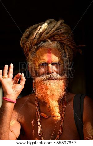 Holy Sadhu Man With Dreadlocks And Traditional Painted Face In Pashupatinath, Nepal