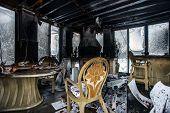 Fire damaged interior details in summer house after blaze poster